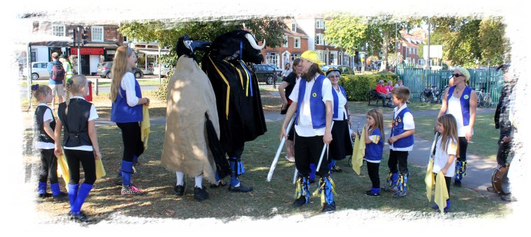 Royal Liberty Morris from Hornchurch in Essex with the Bull mascot and a crazy hooden horse