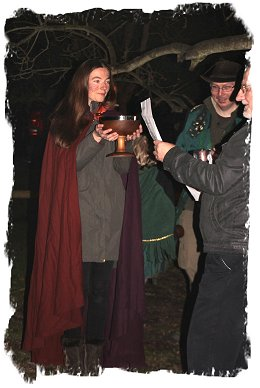 The Wassail reading - Rowena offers bowl to Vortigern – apple yowling – The Gate Inn, Marshside, Kent - 3rd East Kent Buffs shoot in the air around the apple tree  ©vcsinden2016