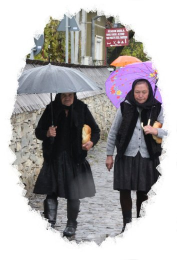 Ladies returning from church in the rain Maramures, ©vcsinden2016