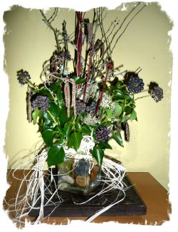 Hedgerow twigs, tied bunch in glass vase. By eco faery Muddypond Green.